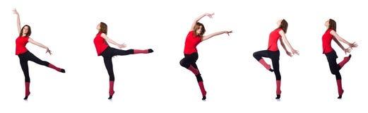 Den unga gymnasten som övar på vit Arkivbild