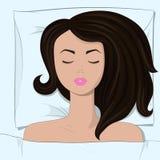Den unga härliga flickan slepping i sängen Royaltyfria Foton