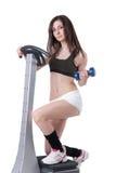 Den unga idrotts- kvinnan annonserar massagemaskinen Royaltyfri Foto