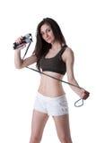 Den unga idrotts- kvinnan som håller en rad med resår, förbinder Royaltyfria Foton