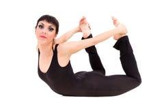 Den unga idrottsman nenkvinnan som gör sträckning, övar Fotografering för Bildbyråer