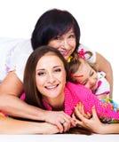 Den unga kvinnan, henne fostrar och dottern royaltyfri foto