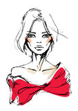 Den unga kvinnan i en röd klänning med en pilbåge Royaltyfri Bild