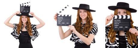 Den unga kvinnan med filmpanelbrädan som isoleras på vit Royaltyfria Bilder
