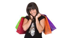 Den unga kvinnan med några shopping hänger lös arkivbilder