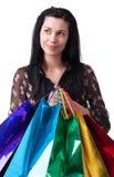 Den unga kvinnan med shopping hänger lös Royaltyfri Bild