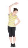 Den unga kvinnan som gör kondition, övar isolerat på vitbakgrund Arkivfoton
