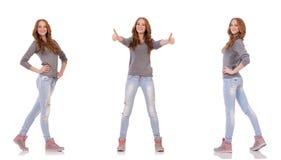 Den unga kvinnan som isoleras på den vita bakgrunden Fotografering för Bildbyråer