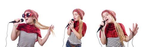 Den unga kvinnliga sångaren med mic på vit Fotografering för Bildbyråer