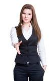 Den unga le affärskvinnan ger handskakningen. Arkivbild
