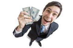 Den unga lyckade affärsmannen visar pengar övre sikt bakgrund isolerad white Arkivfoto