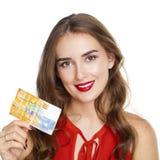 Den unga lyckliga brunettkvinnan rymmer 10 schweizisk franc Royaltyfri Fotografi