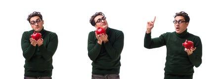 Den unga mannen för nerd med piggybank som isoleras på vit royaltyfri fotografi