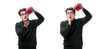 Den unga mannen för nerd med piggybank som isoleras på vit arkivbilder