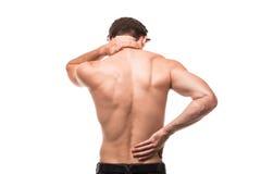 Den unga mannen med tillbaka smärtar i baksida på vit bakgrund arkivbilder