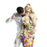 Den unga mannen och den härliga damen i blomma klär Royaltyfri Foto