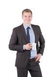 Den unga mannen rymmer en kopp kaffe royaltyfri fotografi
