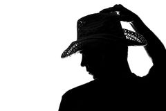 Den unga mannen rymmer handhattkonturn Royaltyfri Foto