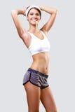 Den unga nätt kvinnan i sport ha på sig arkivfoto