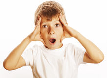 Den unga nätta pojken som undrar framsidan, isolerade nära övre för gest arkivbilder