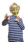 Den unga pojken med vänder mot målningmonster Royaltyfria Foton