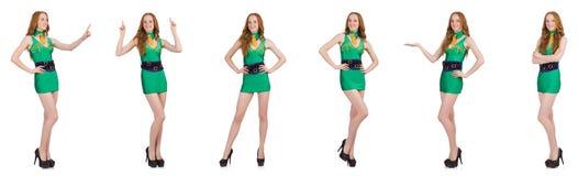 Den unga sexiga flickan i den gröna klänningen som isoleras på vit royaltyfria foton
