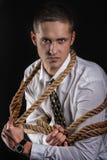 Affärsman som binds upp med repet Royaltyfri Foto