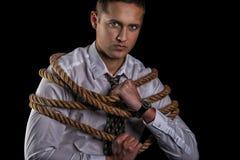Affärsman som binds upp med repet Royaltyfria Bilder