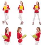 Den unga studenten med böcker på vit Royaltyfri Fotografi
