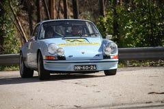 Den Unknow chauffören kör en Porsche 911 Fotografering för Bildbyråer