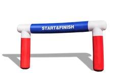 Den uppblåsbara starten - avsluta bågen för sportkonkurrens på vit bakgrund arkivbild