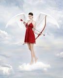 Cupid i moln Arkivfoton