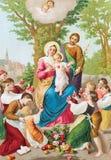 Den utskrivavna traditionella katolska bilden av den heliga familjen Arkivfoton