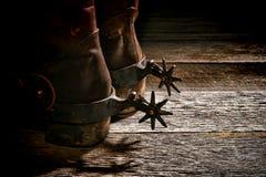 Den västra amerikanska västra rodeon sporrar på cowboyen Boots royaltyfria foton