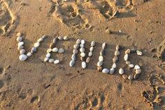 Den Venus inskriften är fodrade stenar på stranden arkivfoton