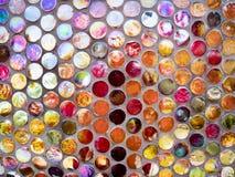 Den vibrerande färgrika formade rundan mönstrar bakgrund royaltyfri foto