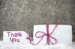 Den vita gåvan, snö, etiketten, text tackar dig, snöflingor Arkivbild