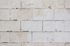 Den vita tegelstenväggen för grunge för backgroun Royaltyfria Bilder