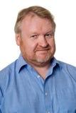 Den vänliga mitt åldrades den skäggiga grabben i blå skjorta - på vit Fotografering för Bildbyråer