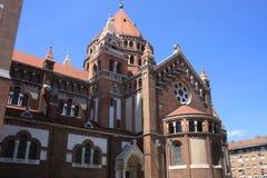 Den Votive kyrkan och domkyrkan av vår dam av Ungern är ett tvilling--spired roman - den katolska domkyrkan i Szeged, Ungern Det  Royaltyfria Foton