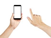 Den vuxna mannen räcker genom att använda den generiska mobiltelefonen med den vita skärmen Arkivbild