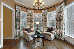 Den with wall of windows. Den in upscale home with wall of windows stock images