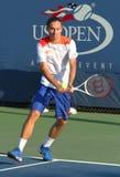 Den yrkesmässiga tennisspelaren Alexandr Dolgopolov från Ukraina under första rundadubbletter matchar på US Open 2013 Arkivfoto