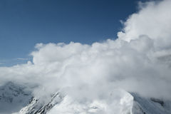 Denali mountain peak clouds Stock Photo