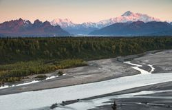Denali Mountain Range Mt McKinley Alaska North America. The last suunlight hits the tip top of The Denali Range and Mt McKinley Chulitna River Stock Images