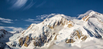 Denali. Panoramic Composition of Denali From Air Above Clouds, Denali National Park and Preserve, Alaska Royalty Free Stock Photography