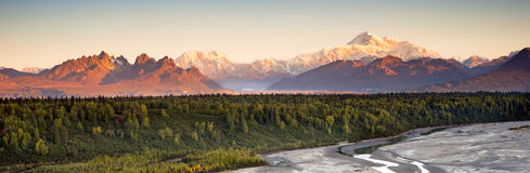 Denali Range Mt McKinley Alaska North America. The sun finally meets the horizon hitting Mount McKinley and the Denali range on a long summer day in Alaska royalty free stock photos