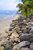 Denarau island Beach, Fji. Fiji's Denarau island beach and rocky shoreline with palms Royalty Free Stock Photography