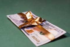 Denaro contante presente di U S valuta Fotografia Stock