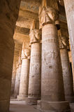 Dendera Temple interior, Ancient Egypt. Imposing columns in the hypostyle hall of Dendera Temple, Qena, Egypt.  The capitals show the goddess Hathor.  Ancient Royalty Free Stock Photos